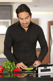 Handsome young modern man cooking healthy recipe Stock Image