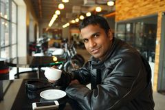 Handsome young motorcyclist Royalty Free Stock Image