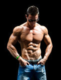 Handsome young muscle man naked wearing only jeans and sunglasses Royalty Free Stock Images