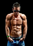 Handsome young muscle man naked wearing only jeans and sunglasses Royalty Free Stock Photography