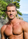 Handsome young muscle man smiling, outdoors Royalty Free Stock Photography