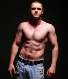 Handsome young muscleman Stock Photography