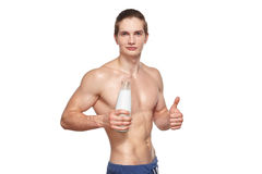 Handsome young muscular athlete holding bottle of Royalty Free Stock Photos