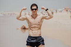Handsome young muscular male model on the beach enjoying summer Stock Photo