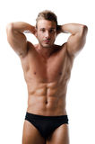 Handsome young muscular man showing ripped abs Stock Photography