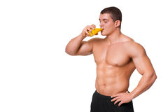 Handsome young muscular sports man drinking juice isolated Stock Photos