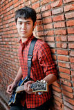Handsome young musician playing the guitar Royalty Free Stock Photography