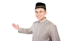 Handsome young muslim man. Portrait of handsome young muslim man present the copy space Royalty Free Stock Images