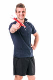 Handsome young personal trainer with clipboard Stock Photography