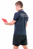 Handsome young personal trainer with clipboard. Standing isolated on white background Royalty Free Stock Photo