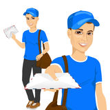 Handsome young post man in blue uniform Royalty Free Stock Image