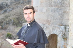 Handsome young priest close up with copy space Royalty Free Stock Images