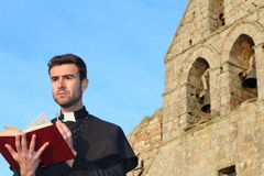 Handsome young priest close up with copy space stock photography