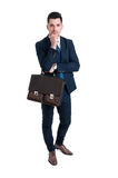 Handsome and young salesman standing isolated on white backgroun Stock Photos