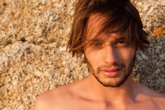 Handsome young shirtless man staring. Close up portrait of a handsome young shirtless man staring Stock Images