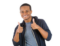 Handsome young smiling man giving two thumbs up Royalty Free Stock Photo