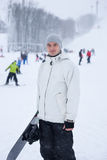 Handsome young snowboarder Stock Photos