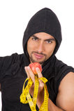 Handsome young strong man holding red apple and Stock Images