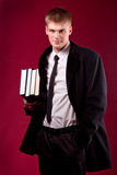 Handsome young student with books Stock Images