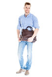 Handsome young student with laptop bag Royalty Free Stock Images