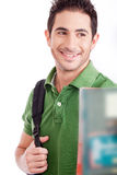 Handsome young student smiling with the books Royalty Free Stock Image