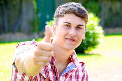 Handsome young succesfull man thumb up Stock Photos