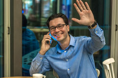 Handsome young successful man doing a welcome gesture. Inviting businessman.Hello I`m  Here Royalty Free Stock Image