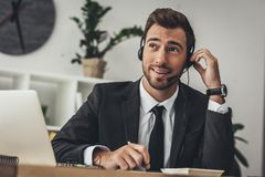 handsome young technical support worker making call royalty free stock image