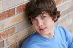 Handsome young teen boy. Against brick wall Royalty Free Stock Image
