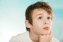 Handsome young teenage boy lost in thought Stock Photos