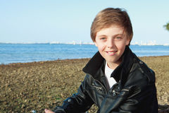 Handsome Young Teenager. Lifestyle image of a handsome young teenager wearing a black leather jacket with Miami's Biscayne Bay in the background stock image