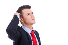 Handsome young thoughtful business man Royalty Free Stock Images