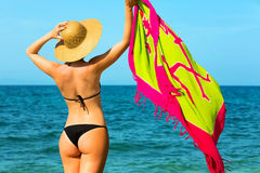 Handsome young woman at the beach Stock Images