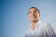 Handsome youth. Youth standing against blue sky looking forward Royalty Free Stock Photos