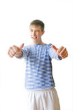 Handsome youth thumbs up Royalty Free Stock Images