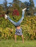 Handspring in park. Student in casual wear show handspring ouutdoor in park Stock Photo