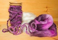 Handspun artyarn and wool fleece Royalty Free Stock Photos
