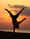 Handstand. Young man is doing an amazing handstand at sunset Stock Photos