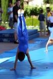 Handstand. Boy at summer gymnastic camp Stock Images