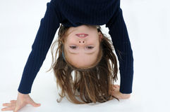 Handstand. Cute little girl makes a handstand Royalty Free Stock Image