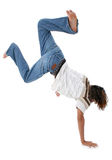 Handstand. Teen boy doing handstand over white Royalty Free Stock Image