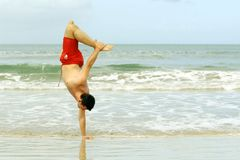 Handstand on the beach Royalty Free Stock Images
