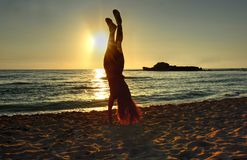 Handstand at the beach. stock photo