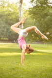Handstand  Exercise On Grass Royalty Free Stock Photography