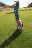 Handstand in the Lawn Royalty Free Stock Images
