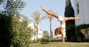 Handstand On The Lawn. Stock Image