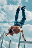 Handstand man. Handstand yoga pose by man on the sky background Royalty Free Stock Photo