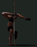 Handstand near the pole. Stock Images