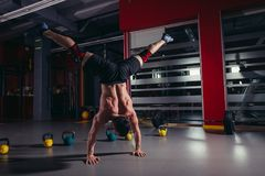 Handstand push-up man workout at gym. Push ups Royalty Free Stock Image