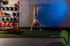 Handstand push-up man workout at gym Stock Photos